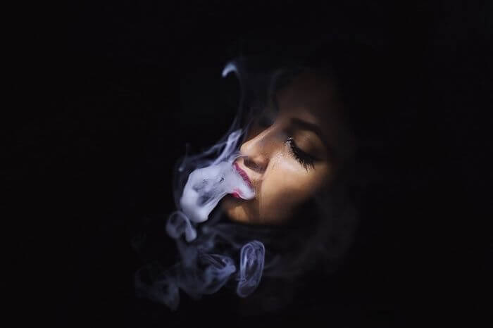 woman with vaping smoke